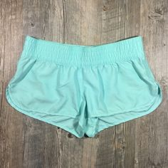Mint green shorts Mint green shorts. Elastic band waist. Polyester. 9 3/4 inches long . 2 1/4 inch inseam. Tag reads large. Xhilaration Shorts