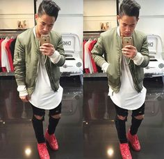 Ripped knee black skinny jeans. Red sneakers. White Long fit shirt. Olive bomber jacket. Fashionista. 2015 men trends