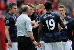 Vidic takes an elbow to the face. No free kick given....smh