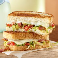 Add color and flavor to a grown-up grilled cheese with Brussels sprouts and cherry tomatoes.