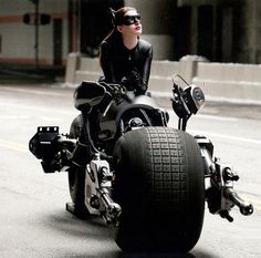 Catwoman ~Anne Hathaway waits . . . Lol I WANT THAT MOTORCYCLE