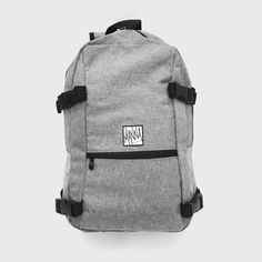 Speckled Grey 13 Litre Street Backpack. Featuring Manna printed patch, front zip…