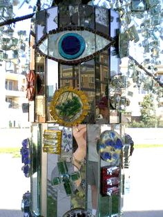 """Shiny, happy mirrored tree trunk from the """"Blinged-Out Universal Tree of Life"""" at the American Visionary Art Museum."""