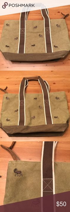 LLBean Large Zipper Tote Bag Moose Print Tan/Brown in color. Used only several times. Few stains as shown in the one photo. Great bag I always thought I would carry for something but just never did. Thanks for looking! L.L. Bean Bags Totes