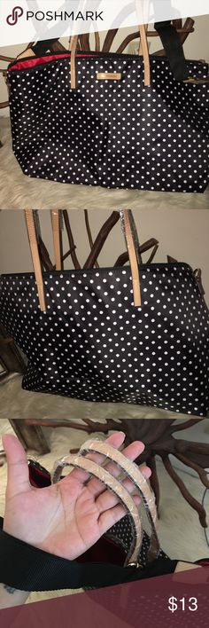 Poka dot bag It's a cute black and white poka dot bag , has a lot of space never been used before. The material is nylon . Bags Totes