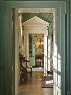 "The progression of rooms in this historic house is accented in Farrow & Ball's paint colors: ""Clunch"" in the living room, ""Pointing"" in the dining room and ""Folly Green"" in the breakfast room. ©Gibbs Smith, Farrow and Ball, Brian D Coleman"