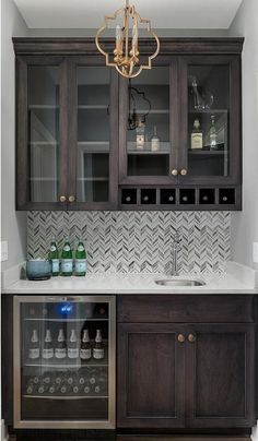 Exquisite brown wet bar boasts dark brown shaker cabinets accented with brass no. Exquisite brown wet bar boasts dark brown shaker cabinets accented with brass nobs and fitted in a Diy Kitchen, Kitchen Decor, Kitchen White, Kitchen Bars, Kitchen Ideas, Kitchen Wet Bar, Rustic Kitchen, Kitchen Modern, Kitchen Layout