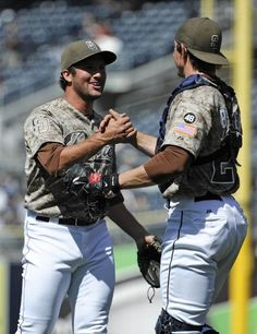 Game #111 8/5/12: Huston Street #16 of the San Diego Padres is congratulated by John Baker #21 after getting the final out in the ninth inning of a baseball game against the New York Mets at Petco Park on August 5, 2012 in San Diego, California. The Padres won 7-3. (Photo by Denis Poroy/Getty Images)