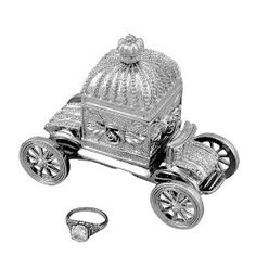 """I think this 'Disney' jewelry box is so cute. It's silver, and shaped like Cinderella's carriage. """"# Feel like Cinderella forever when you store your wedding ring in this fairy-tale-inspired keepsake box # Holder in shape of carriage with removable magnetic top and movable wheels # Made of pewter with rhodium finish and beautiful blue velvet lining # Use box to hold ring on nightstand or use on a ring pillow at your wedding ceremony""""."""