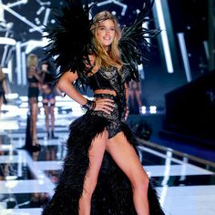 Leave it to Doutzen Kroes to ROCK a feathered skirt & wings. | Very Sexy Corset & Matching Panty
