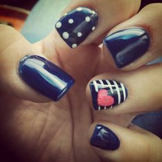 Navy blue white stripes with a cute pink heart nail design :)