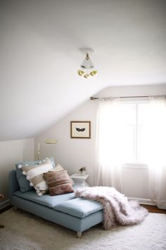 low seating in an attic makes the most of a small space - layers make it extra cozy! | coco+kelley
