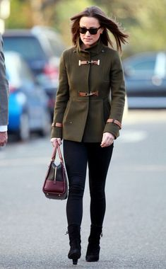 Pippa Middleton topped off her urban sophisticate style in an olive peacoat with tan leather buckles.