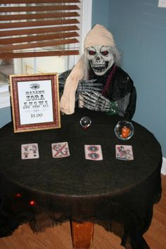 Zola fortune teller station. & Halloween fortune teller table with glowing potion bottles ...