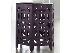 A sparkly boysenberry finish against a delicate geometric cutout pattern makes the Hexagonal Table delightful.