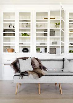 display shelves and grey sofa