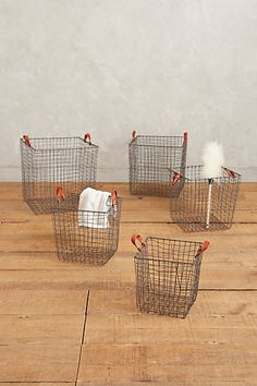 Gatehouse Storage Baskets #anthropologie See the leather pulls on the sides?  Could totally make those for the wire baskets that I am thinking of making.