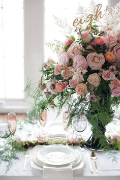 Pink rose table centrepiece by Paula Rooney Weddings and Events