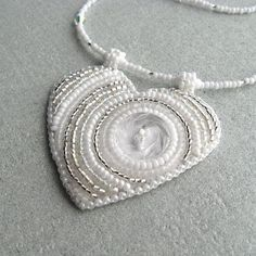 This bead-embroidered heart is so simple, yet it keeps calling to me!  $55.44