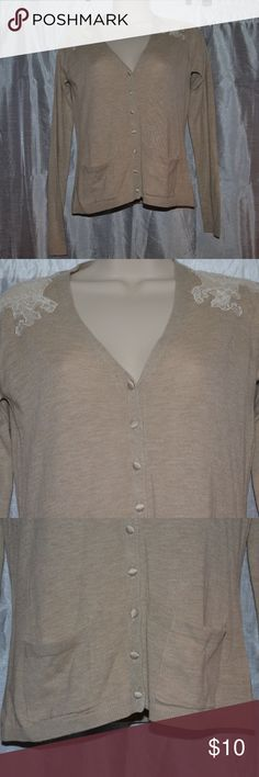 """EUC ZARA KNIT TAN LACE CARDIGAN SWEATER SMALL So Pretty! pair with jeans or a skirt! ZARA TAN LACE CARDIGAN SWEATER SIZE: SMALL MATERIAL: 100% ACRYLIC (2) FRONT POCKETS  TAN FABRIC FRONT BUTTONS CLOSURE LACE SHOULDER FINISH MEASUREMENTS:      SHOULDER TO SHOULDER: 14""""      ARMPIT TO ARMPIT: 17""""     SLEEVE: 24""""      LENGTH: 22""""  Very Good - Excellent Condition No smell, no stains, no tears. Smoke/Pet free home Let's Bundle! Do I hear Offers?! Let's make it happen! Thank you for looking! Zara…"""
