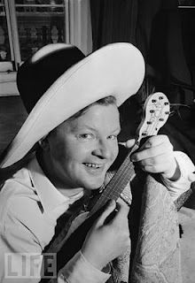 Benny Hill. I'm not sure if this will promote or demote the ukulele to a whole new level.  www.facebook.com/Eddy.Finn