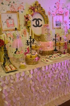 Pretty dessert table at a Chanel engagement party! See more party planning ideas at CatchMyParty.com!