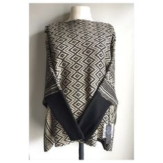 NWT gorgeous poncho sweater size small New With Tags gorgeous poncho sweater size small. Could also fit size Medium. Perfect for those cool outdoor days when don't want to wear a jacket. Poof! Sweaters Shrugs & Ponchos