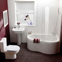 Small Combine Bathroom with corner set bath tub, wall decoration with tiles and Brown tiles flooring.