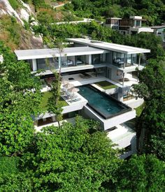 Villa Amanzi in Phuket, Thailand designed by Original Vision Architecture. The villa is nestled in a cascading, west facing ravine, with a dramatic granite slab at the northern edge, and the sparkling Andaman Sea to the south. Architecture Design, Amazing Architecture, Contemporary Architecture, Landscape Architecture, Contemporary Design, Modern Design, Organic Architecture, Architecture Interiors, Building Architecture