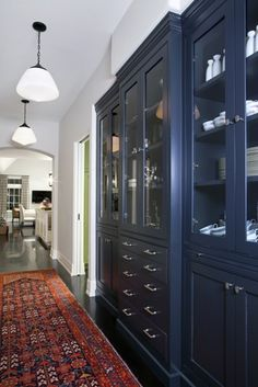You could do this for the cabinets in the hall to the kitchen, the ones connected to the oven.  So fun to use navy.