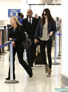 Kendall Jenner wearing Ash Bowie Wedge sneakers Yeezus Tour Merch Bomber Jacket