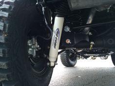 Driver side rear suspension with 4 inch Pro Comp lift kit on 2016 Wrangler Unlimited Sport, 2016 Jeep Wrangler, Pro Comp, Bar Led, Chrysler Dodge Jeep, Led Flood Lights, Lift Kits, Fender Flares, Led Light Bars
