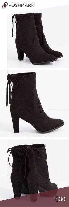 Black Drawstring Mid Calf Heel Boot  size 7 Black Drawstring Mid Calf Heel Boot By Hot Kiss size 7 Kick things up a notch in these trendy half calf heeled boots. Constructed with faux suede, fashioned with a slouchy construction with a drawstring back and a flirty heel to match. By Hot Kiss Height: 10 in.; 3.5 in. heel Slip on Non-skid sole Man-made materials Imported Hot Kiss Shoes Heeled Boots