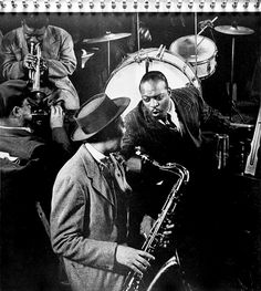 Count Basie and Lester Young This picture of Lester Young and Count Basie is one of another 30 great b/w photos that are included in the beautiful 78 rpm album (six records) that Norman Granz produced and issued in 1949. It was distributed by Mercury and entitled The Jazz Scene. The album is spiral bound into a portfolio book, and the cover is plain black. So this photo will better tell about it. The photographer is Gjon Mili.