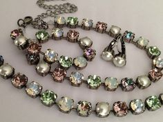 Swarovski crystal necklace featuring 8mm light rose, antique pink, chrysolite opal, chrysolite, light vitrail , pearl, crystal ab Adjustable up to 19' but can be altered upon request.  Bracelet and drops are also available in my shop.   Pictures in antique silver