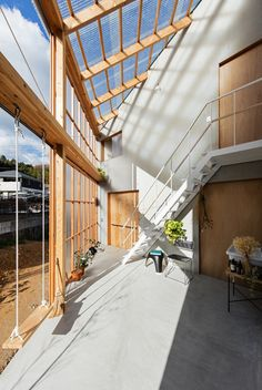 World Architecture Community News - Huge corrugated polycarbonate wall lightens a cornered sunroom in house by Tato Architects Architecture Design, Modern Japanese Architecture, Minimalist Architecture, Sustainable Architecture, Residential Architecture, Pavilion Architecture, Chinese Architecture, Architecture Office, Futuristic Architecture