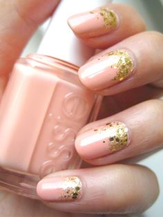 1. Start with a base coat. 2. Apply two coats of a light pink polish to your nails, like Essie Management, $7. 3. Once dry, apply a few coats of (small) gold glitter polish around the base of your nail. Then, apply a layer of the (big) gold glitter polish on top. (Never take the gold past the halfway point of your nail.) 4. To finish, seal with a top coat.