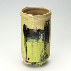 This is a thrown and marked slipware pot by Barry Stedman using a red earthenware body.