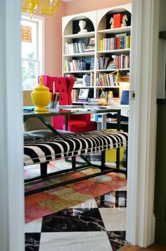 Love the bookshelves on a wall with a table in the middle of the room!