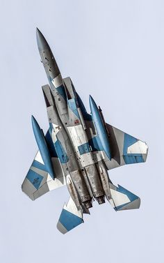 Aircraft. Grey with blue and white geometric shapes.