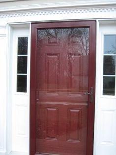 Bright painted door and storm door. Front Door With Screen, Front Door Entrance, Entry Doors, Front Porch, Screen Doors, Front Entry, Front Door Paint Colors, Painted Front Doors, Outside Furniture