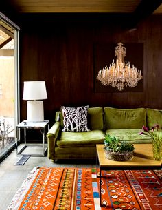 Cement floor condo made cozy with a Moroccan Kilim rug and a green velvet sofa. A large painting on the wall behind the sofa gives the illusion of a big chandelier. Decor, Living Room, Room, Green Sofa, Interior, Beautiful Carpet, Room Inspiration, House Interior, Interior Design