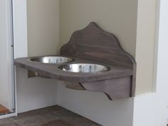 Wall mounted dog bowls - a totally free standing unit drilled to the wall.  No need to move every time we vacuum and wash the floor.