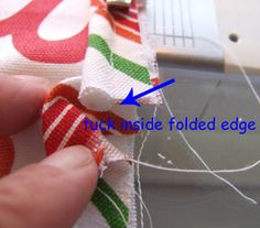 piping-Turn under one short end of the bias strip; encase the cording by folding the bias strip around it– starting the cording about 1/2″ from the end. When you reach the end clip the piping so that it meets the cording at the beginning, tuck it into the folded edge and stitch in place.