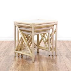 This set of 3 beach chic nesting tables are featured in a rattan with a whitewashed wood finish. These 3 coastal end tables have glass table tops, woven wrapped corners and angled side rails. Perfect as plant stands on a covered porch or patio! #coastal #tables #endtable #sandiegovintage #vintagefurniture