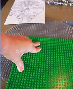 Giving the cake board the Lego look - For all your cake decorating supplies, please visit craftcompany.co.uk