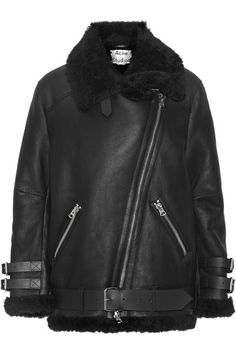 SURE THING, SHEARLING: Acne Studios' 'Velocite' shearling jacket will keep you warm and cozy while adding an effortlessly cool feel to weekend looks. This plush, oversized design is finished with classic biker details, including buckled cuffs and an asymmetric zipped front. Adjust the straps to find your perfect fit.