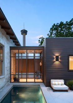This is a residence in San Antonio TX with the Tower of Americas in the background - Poteet Architects -love the modern against old charm