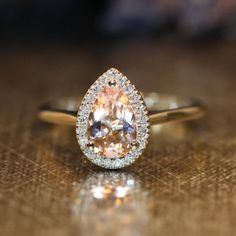 Still my absolute favorite engagement ring i've seen yet. Morganite Halo Diamond Engagement Ring in 14k by LaMoreDesign