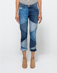 Modern patchwork boyfriend jean from Current/Elliott. Features zipper fly with detailed top button closure, five pocket styling, whiskering detail, multi-tone, slim boyfriend cut, cropped length, slightly taped leg and low on the hips fit. • Patchwork